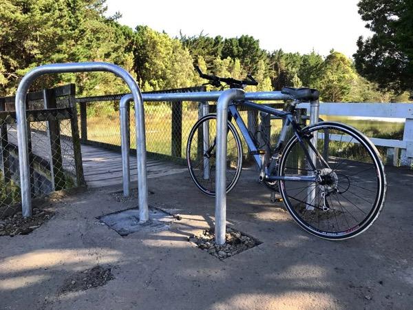 Bridge bars, looking north, with bike.