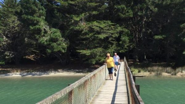 Julie Gordon and her husband, Brett on the bridge at Waikawa Beach, New Zealand.