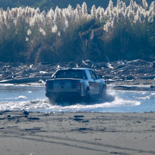 Ute leaving the beach.
