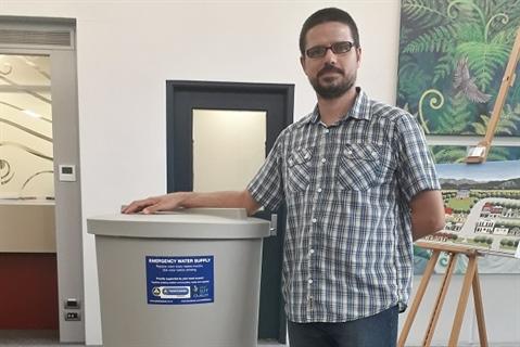Albert Hoffman with emergency water storage tank.
