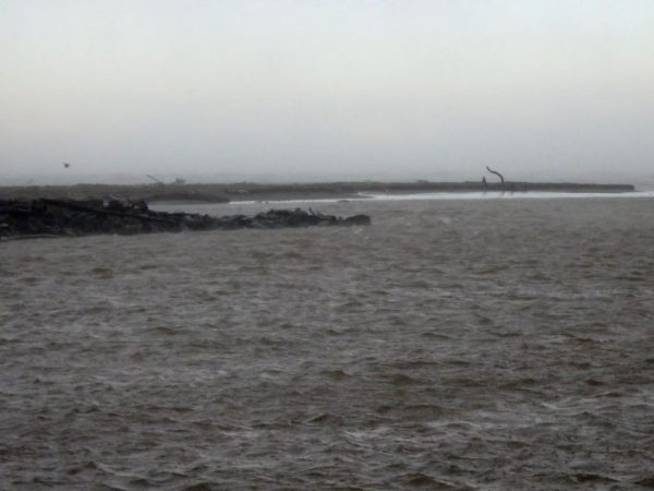 The river cut has breached by the rock groyne.