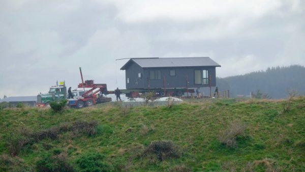 A house arrives on a truck.