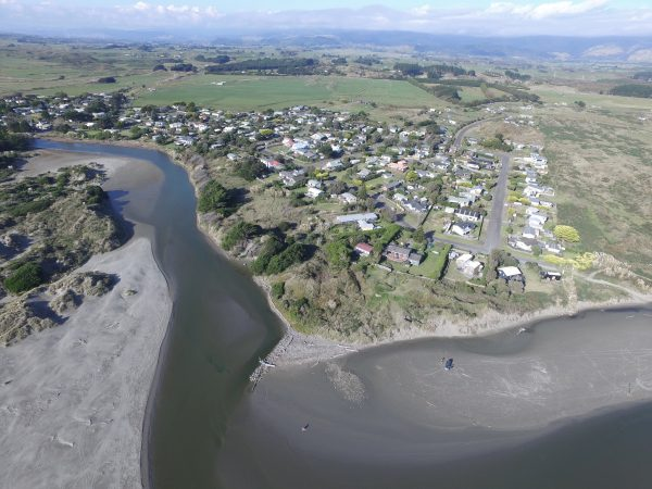 Throat of Waikawa River, looking north with village on the south bank.