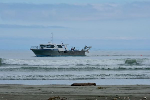 Fishing vessel 63018 working very close to shore, photo from beach.
