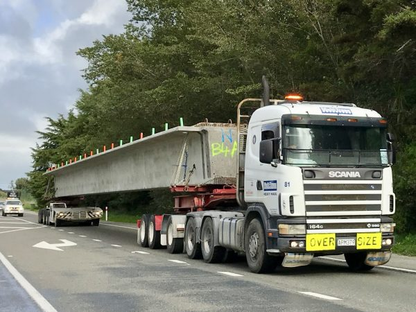Huge concrete beam on a truck.
