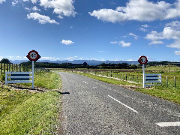 Village exit speed sign - 80 Kph.