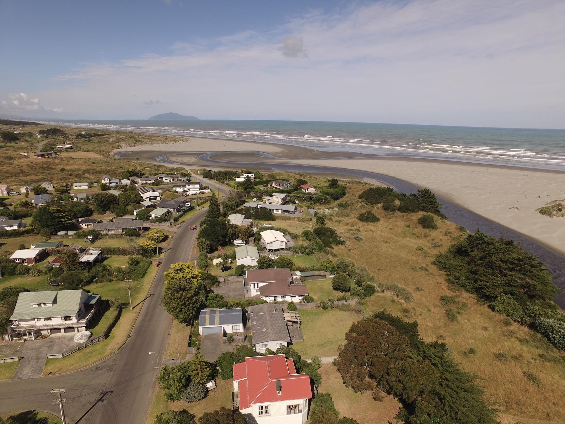 Drone Photo 01: Manga Pirau Street and river mouth.