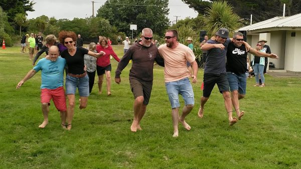 Adults in a 3-legged race.