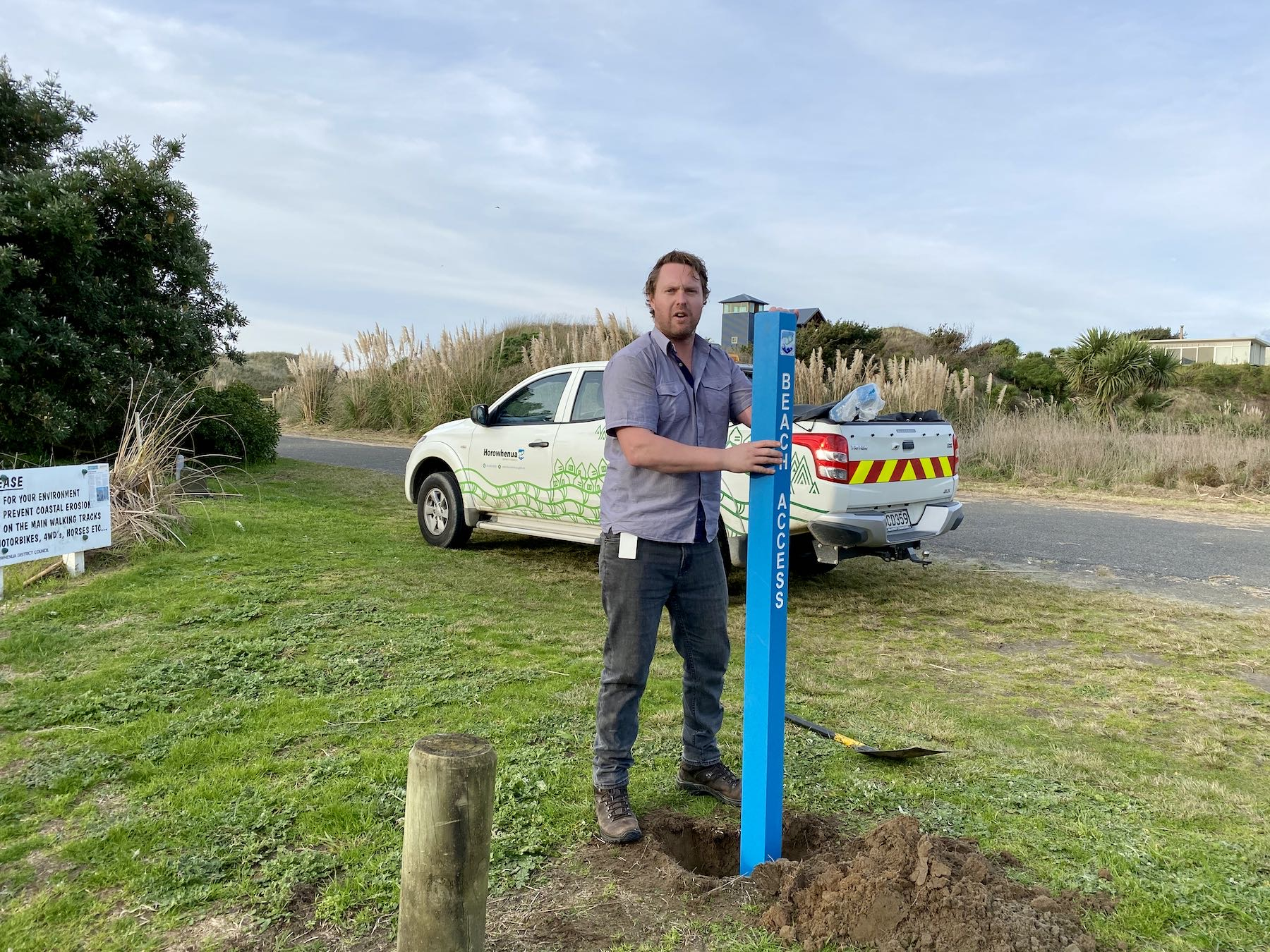 Ben Wood installs a beach access post at the north track.